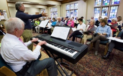 Jack Horner leads singing as Mickey McInnish plays keyboards during the Side by Side Singers practice at First United Methodist Church in Montgomery, Ala. on Tuesday October 27, 2015. The choir is made up of people with dementia, their family members and volunteers at the Respite Ministry at the church.